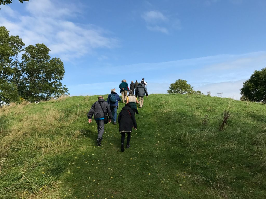 Guests walking up the great hill at Navan Fort - Co. Armagh